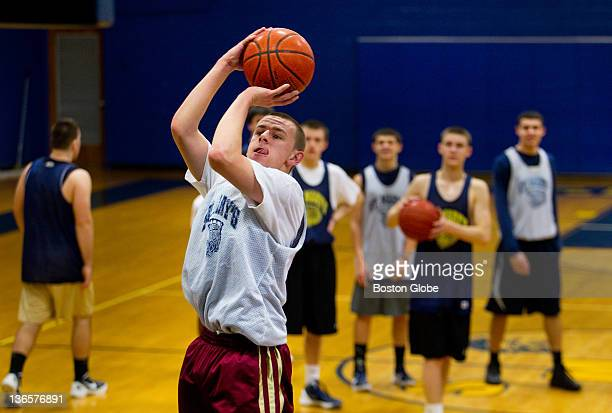 Matt Manning a junior from Peabody practices his skills during practice with St Mary's High School boys' basketball team a favorite to win the...