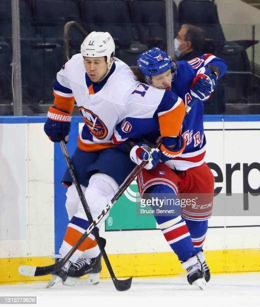 Matt Martin of the New York Islanders and Artemi Panarin of the New York Rangers get tangled during the first period at Madison Square Garden on...