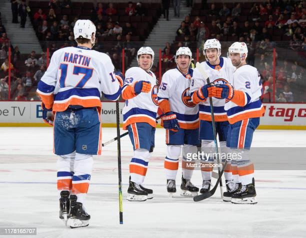 Matt Martin of the New York Islanders celebrates his second period goal against the Ottawa Senators with teammates Nick Leddy Noah Dobson Cal...