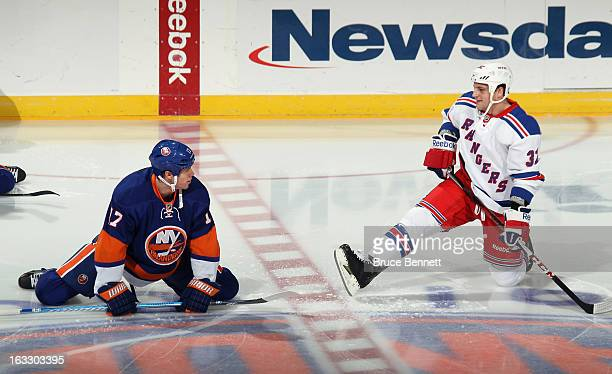 Matt Martin of the New York Islanders chats with former teammate Micheal Haley of the New York Rangers during warmups at the Nassau Veterans Memorial...