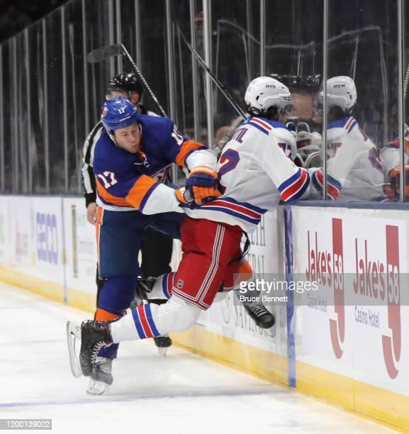 Matt Martin of the New York Islanders checks Filip Chytil of the New York Rangers at NYCB Live's Nassau Coliseum on January 16, 2020 in Uniondale,...