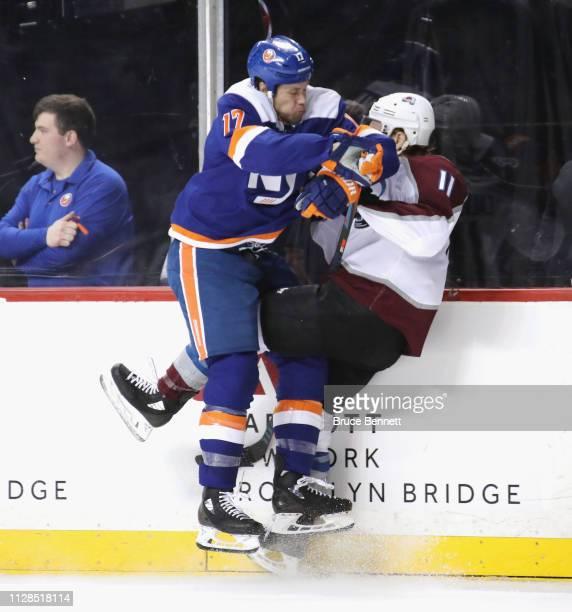 Matt Martin of the New York Islanders checks Matt Calvert of the Colorado Avalanche during the second period at the Barclays Center on February 09,...