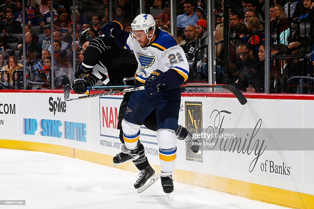 Matt Martin #17 of the New York Islanders hits Kevin Shattenkirk #22 of the St. Louis Blues during the game at the Barclays Center on December 4, 2015 in Brooklyn borough of New York City.
