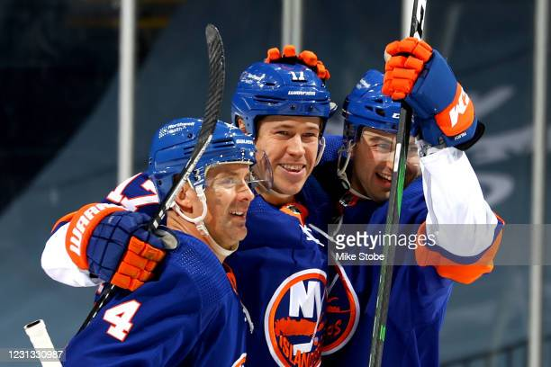 Matt Martin of the New York Islanders is congratulated by Andy Greene and Adam Pelech after scoring a goal against the Buffalo Sabres during the...