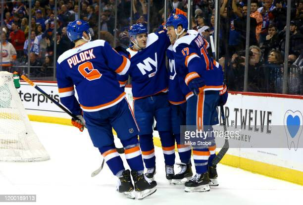 Matt Martin of the New York Islanders is congratulated by his teammates after scoring a goal against the Philadelphia Flyers during the first period...