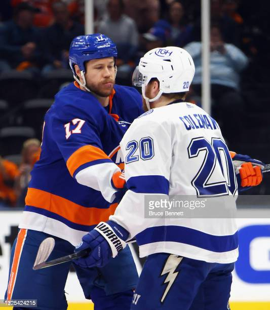 Matt Martin of the New York Islanders pushes on Blake Coleman of the Tampa Bay Lightning in Game Six of the NHL Stanley Cup Semifinals during the...