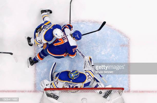 Matt Martin of the New York Islanders scores his second goal of the game against Jonas Johansson of the Buffalo Sabres during the third period at the...