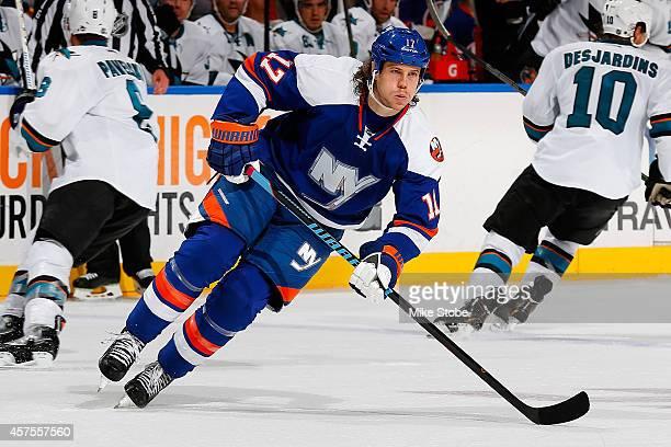 Matt Martin of the New York Islanders skates against the San Jose Sharks at Nassau Veterans Memorial Coliseum on October 16, 2014 in Uniondale, New...