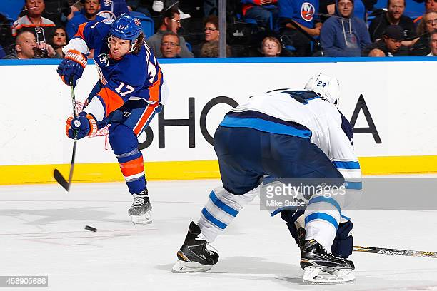 Matt Martin of the New York Islanders skates against the Winnipeg Jets at Nassau Veterans Memorial Coliseum on October 28, 2014 in Uniondale, New...