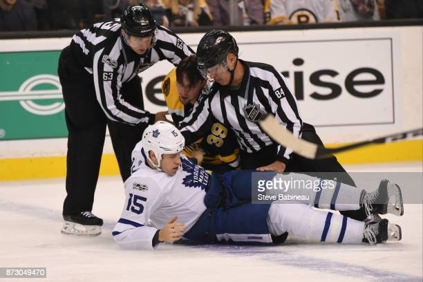 Matt Martin of the Toronto Maple Leafs gets phyiscal with Matt Beleksey of the Boston Bruins at the TD Garden on November 11, 2017 in Boston,...