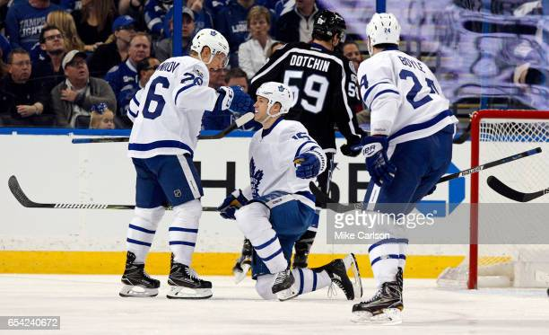 Matt Martin of the Toronto Maple Leafs is congratulated by Nikita Soshnikov after scoring against the Tampa Bay Lightning during the second period at...