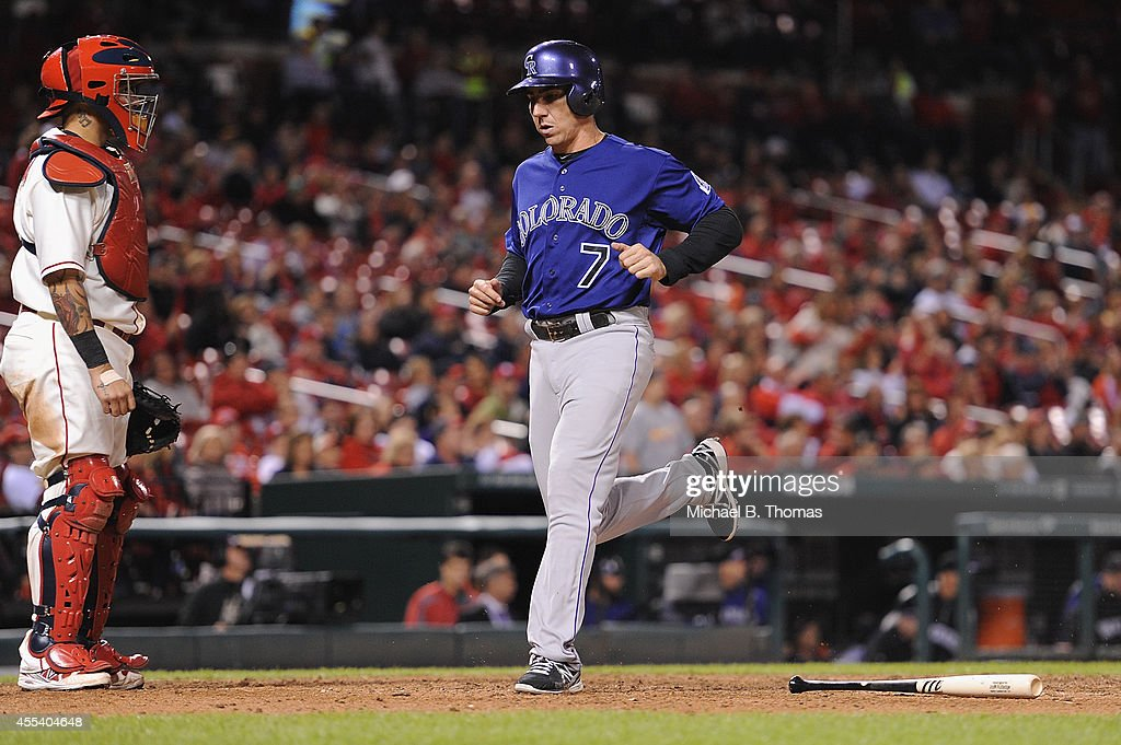 Matt McBride #7 of the Colorado Rockies scores on a sacrifice fly in the ninth inning against the St. Louis Cardinals at Busch Stadium on September 13, 2014 in St. Louis, Missouri. The Cardinals defeated the Rockies 5-4.
