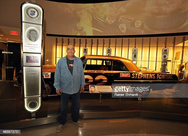 Matt McDaniel grandson of 2014 inductee Fireball Roberts poses with his grandfather's car during the NASCAR Hall of Fame inductee exhibit unveiling...