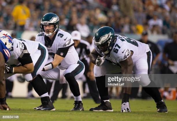 Matt McGloin and Chance Warmack of the Philadelphia Eagles plays against the Buffalo Bills the preseason game at Lincoln Financial Field on August 17...