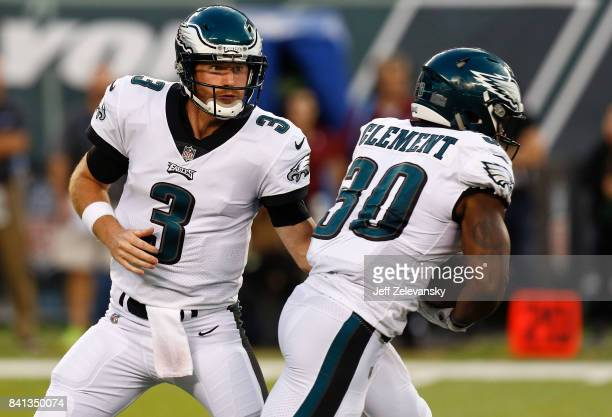 Matt McGloin hands off to Corey Clement of the Philadelphia Eagles during their preseason game against the New York Jets at MetLife Stadium on August...