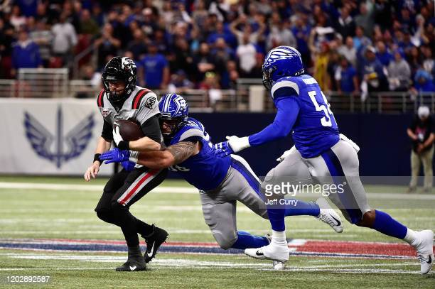 Matt McGloin of the NY Guardians is sacked by Casey Sayles of the St. Louis Battlehawks during the first half of an XFL game at The Dome at America...