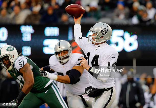 Matt McGloin of the Oakland Raiders in action against the New York Jets on December 8, 2013 at MetLife Stadium in East Rutherford, New Jersey. The...