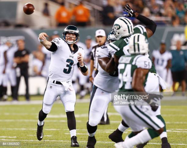 Matt McGloin of the Philadelphia Eagles looks to pass against the New York Jets during their preseason game at MetLife Stadium on August 31, 2017 in...