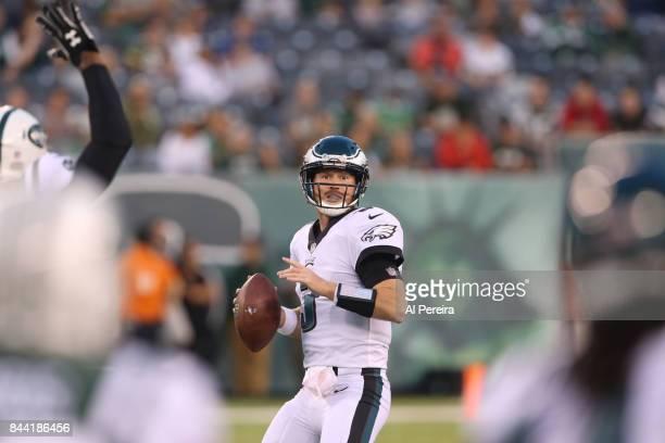 Matt McGloin of the Philadelphia Eagles passes the ball against the New York Jets during their preseason game at MetLife Stadium on August 31, 2017...