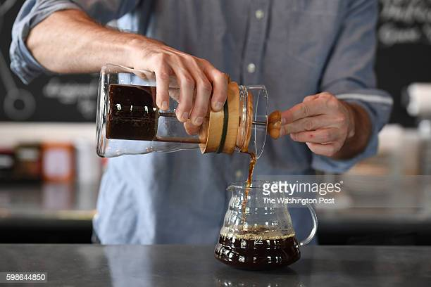 Matt McGuire coffee director at the Coffee Bar on S St NW demonstrates the process for coldbrew coffee concentrate for a photograph on Thursday...