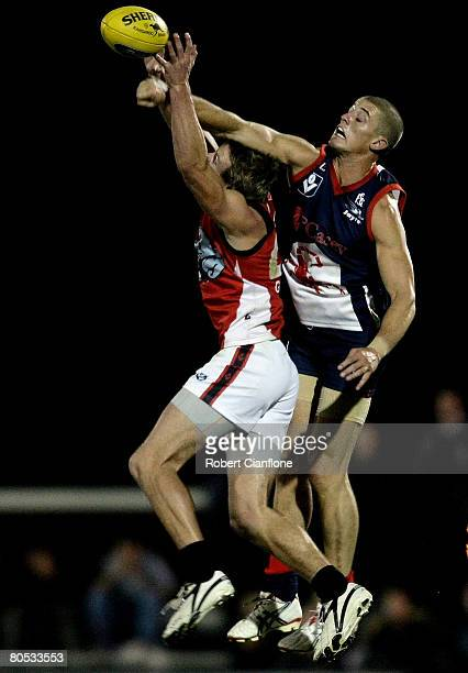 Matt McGuire of the Scorpions spoils the ball for Alexander Lee of the Dolphins during the round two VFL match between the Casey Scorpions and...