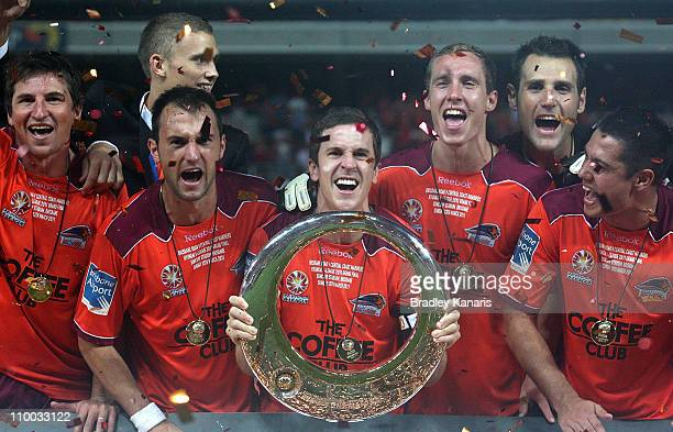 Matt McKay and team mates celebrate victory after the ALeague Grand Final match between the Brisbane Roar and the Central Coast Mariners at Suncorp...
