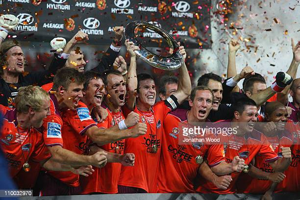 Matt McKay and team mates celebrate victory in the ALeague Grand Final match between the Brisbane Roar and the Central Coast Mariners at Suncorp...