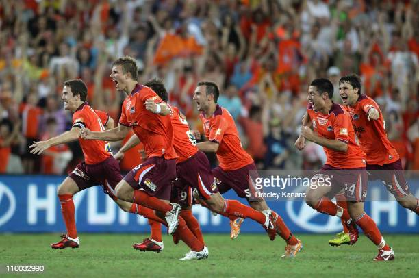 Matt McKay Eric Paartalu and team mates celebrate victory the ALeague Grand Final match between the Brisbane Roar and the Central Coast Mariners at...