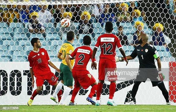 Matt McKay of Australia scores the opening goal during the 2015 Asian Cup match between Oman and Australia at ANZ Stadium on January 13 2015 in...