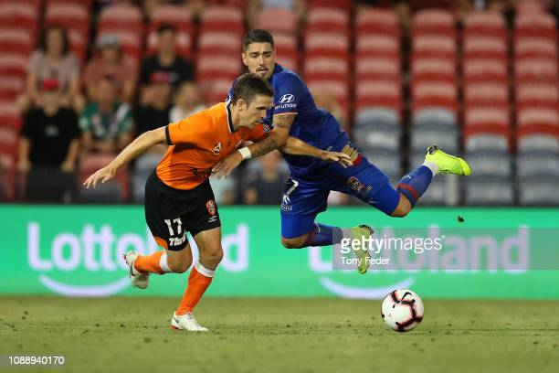 Matt McKay of the Brisbane Roar contests the ball with Dimitri Petratos of Newcastle Jets during the round 12 ALeague match between the Newcastle...