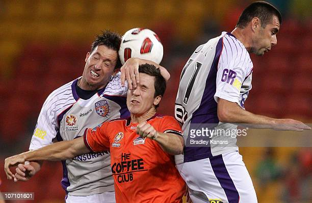 Matt McKay of the Roar and Robbie Fowler of the Glory compete for the ball during the round 17 ALeague match between the Brisbane Roar and the Perth...