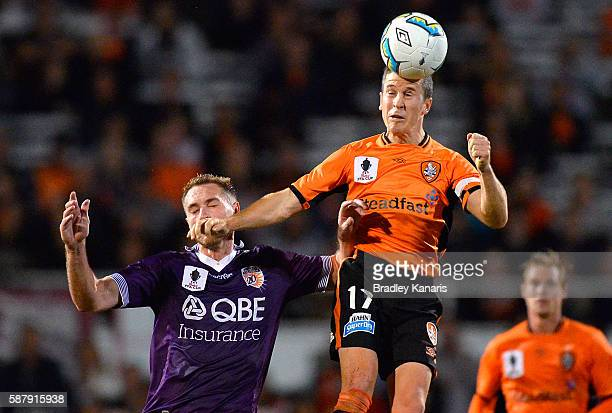 Matt McKay of the Roar and Rostyn Griffiths of the Glory challenge for the ball during the FFA Cup round of 32 match between the Brisbane Roar and...