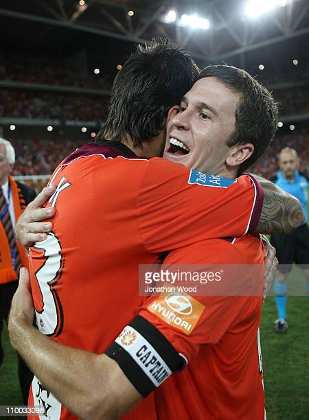 Matt McKay of the Roar celebrates with Milan Susak after victory in the A-League Grand Final match between the Brisbane Roar and the Central Coast...