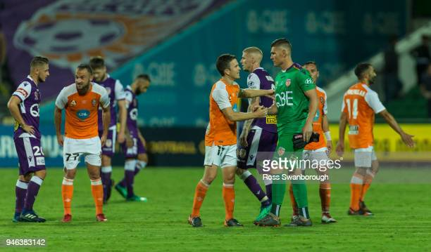 Matt McKay of the Roar congratulates Goalkeeper Liam Reddy of the Glory on his 250th game at nib Stadium on April 14 2018 in Perth Australia