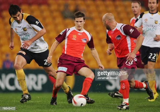 Matt McKay of the Roar in attack during the round three A-League match between the Queensland Roar and the Central Coast Mariners at Suncorp Stadium...