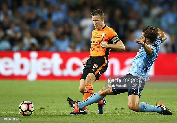 Matt Mckay of the Roar is tackled by Josh Brilliante of Sydney FC during the round 13 ALeague match between Sydney FC and Brisbane Roar at Allianz...