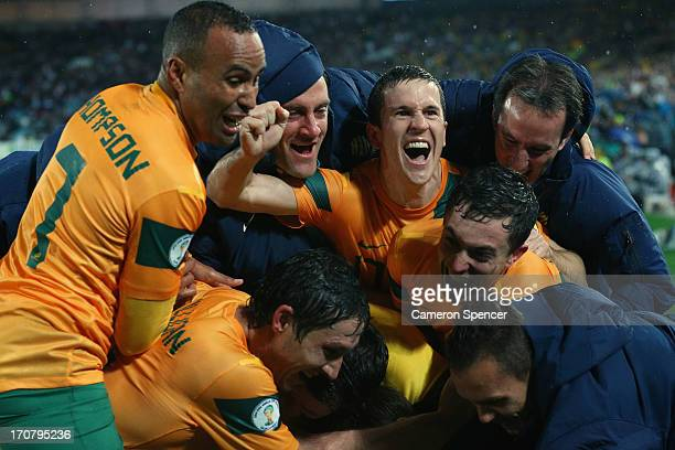 Matt McKay of the Socceroos and team mates celebrate after Josh Kennedy scored a goal during the FIFA 2014 World Cup Asian Qualifier match between...