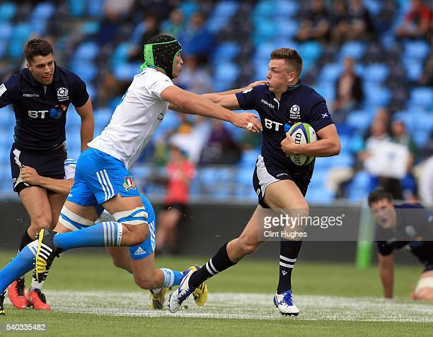 Matt McPhillips of Scotland is tackled by Lorenzo Masselli of Italy during the World Rugby U20 Championship match at the The Academy Stadium on June...
