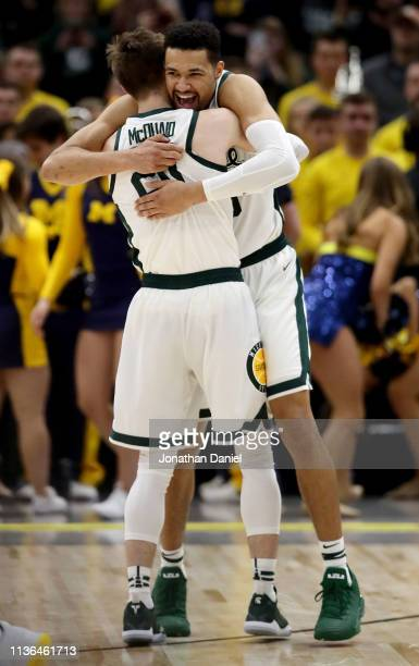 Matt McQuaid and Kenny Goins of the Michigan State Spartans celebrate in the second half against the Michigan Wolverines during the championship game...
