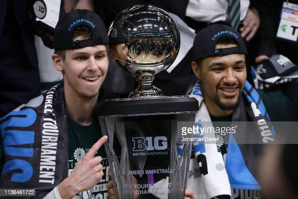 Matt McQuaid and Kenny Goins of the Michigan State Spartans pose for photos after beating the Michigan Wolverines 6560 in the the championship game...