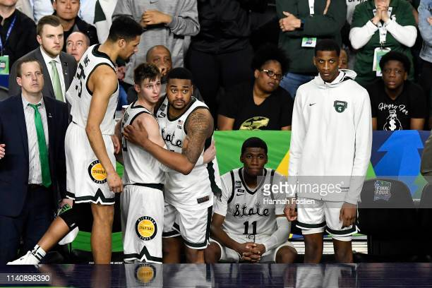 Matt McQuaid and Nick Ward of the Michigan State Spartans react on the bench in the second half against the Texas Tech Red Raiders during the 2019...