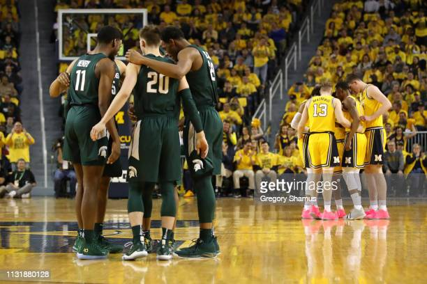 Matt McQuaid of the Michigan State Spartans and his teammates prepare to play the Michigan Wolverines at Crisler Arena on February 24 2019 in Ann...