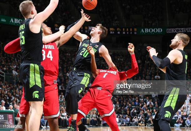 Matt McQuaid of the Michigan State Spartans battles for a loose ball against Luther Muhammad of the Ohio State Buckeyes in the second half at Breslin...