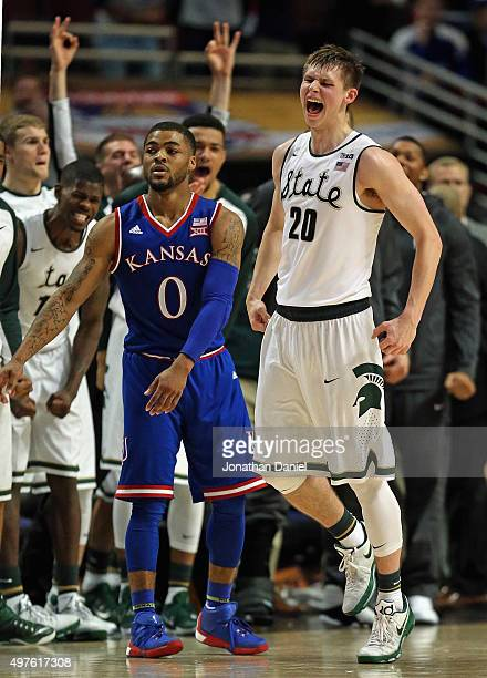 Matt McQuaid of the Michigan State Spartans celebrates after hitting a three point shot over Frank Mason III of the Kansas Jayhawks during the...