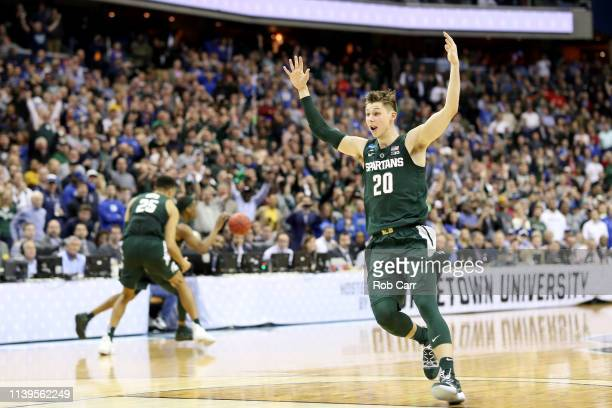 Matt McQuaid of the Michigan State Spartans celebrates after defeating the Duke Blue Devils in the East Regional game of the 2019 NCAA Men's...