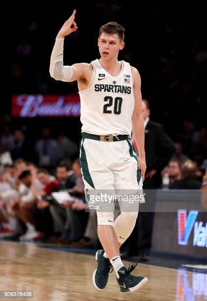 Matt McQuaid of the Michigan State Spartans celebrates his three point shot that helped cement the win over the Wisconsin Badgers during...