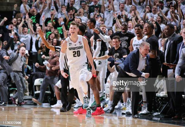 Matt McQuaid of the Michigan State Spartans celebrates his threepoint basket in the second half against the Rutgers Scarlet Knights at Breslin Center...
