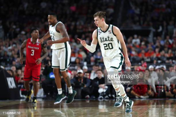 Matt McQuaid of the Michigan State Spartans celebrates in the first half against the Texas Tech Red Raiders during the 2019 NCAA Final Four semifinal...
