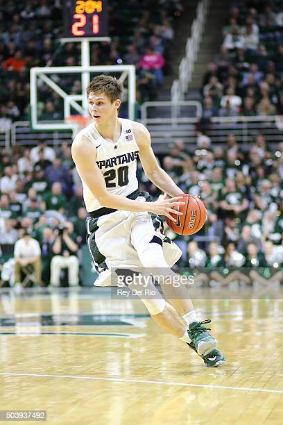 Matt McQuaid of the Michigan State Spartans dribbles the ball during the game against the Illinois Fighting Illini in the second half at the Breslin...