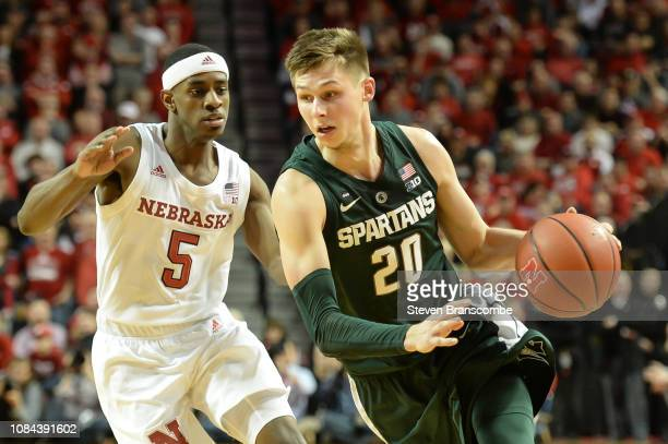 Matt McQuaid of the Michigan State Spartans drives against Glynn Watson Jr #5 of the Nebraska Cornhuskers at Pinnacle Bank Arena on January 17 2019...
